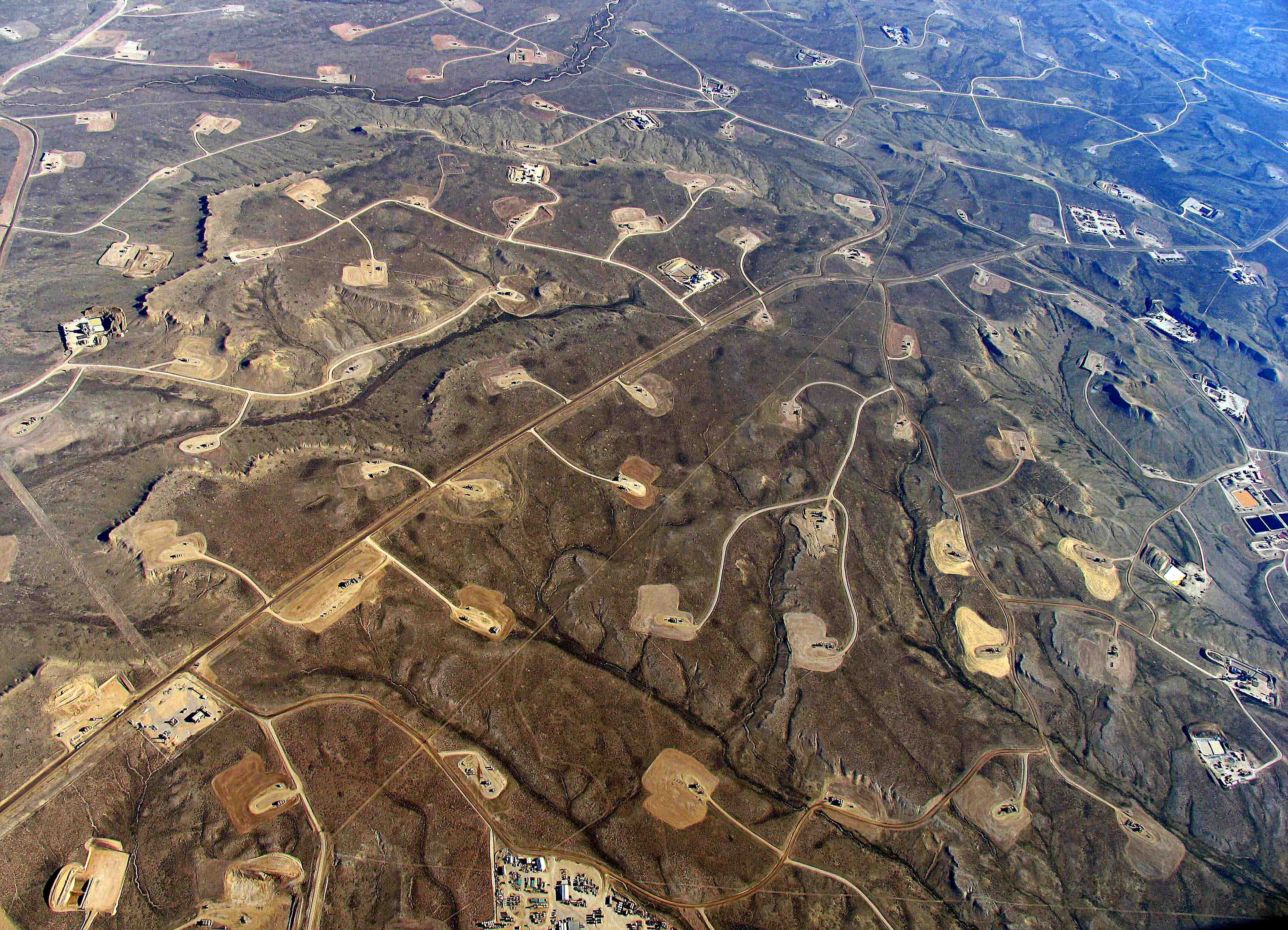 Shale-fracking-dense-web-roads-pipeline-and-well-pads-turn-continuous-forest-and-grasslands-into-fragmented-islands..jpg