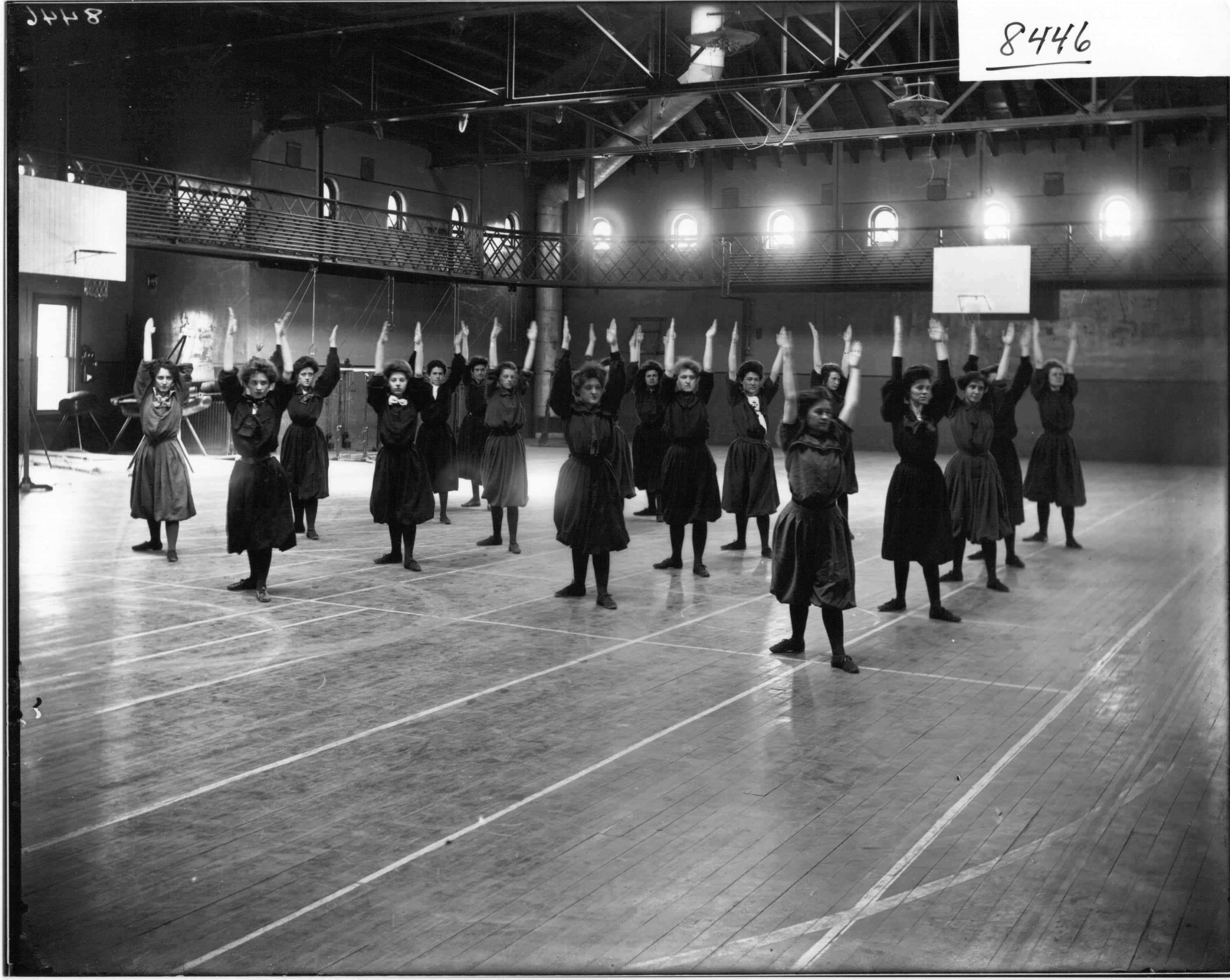 Women-performing-calisthenics-for-exhibition-in-Herron-Gymnasium-1908-Miami-University-by-Frank-R-Snyder
