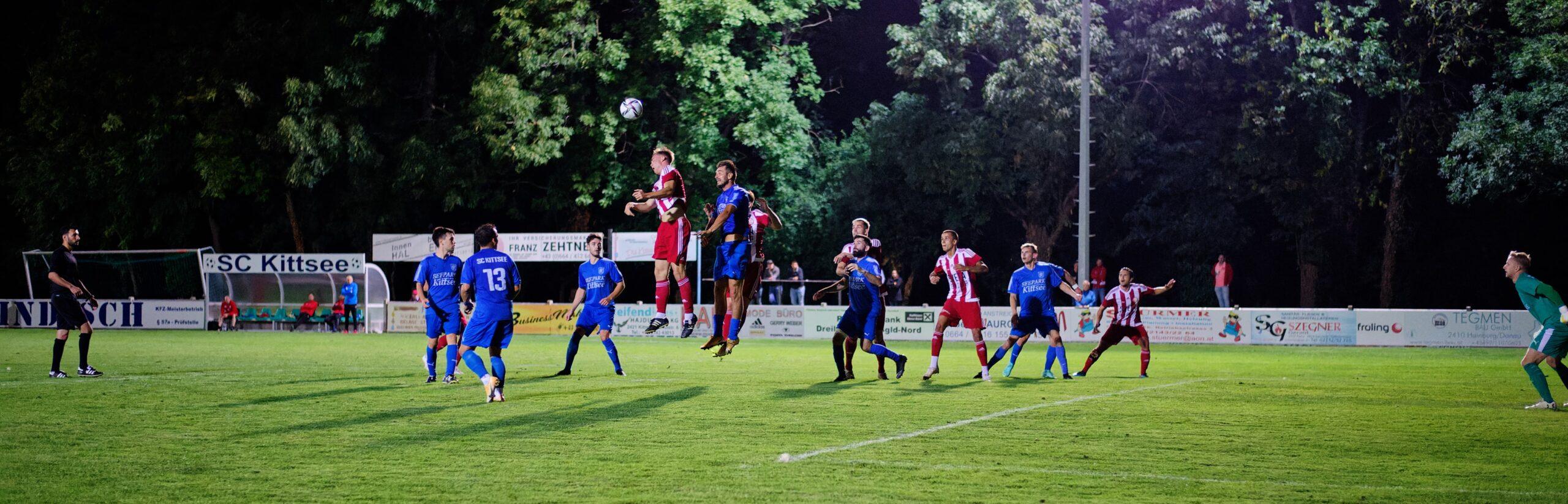 Buliga and Machovec compete for a header