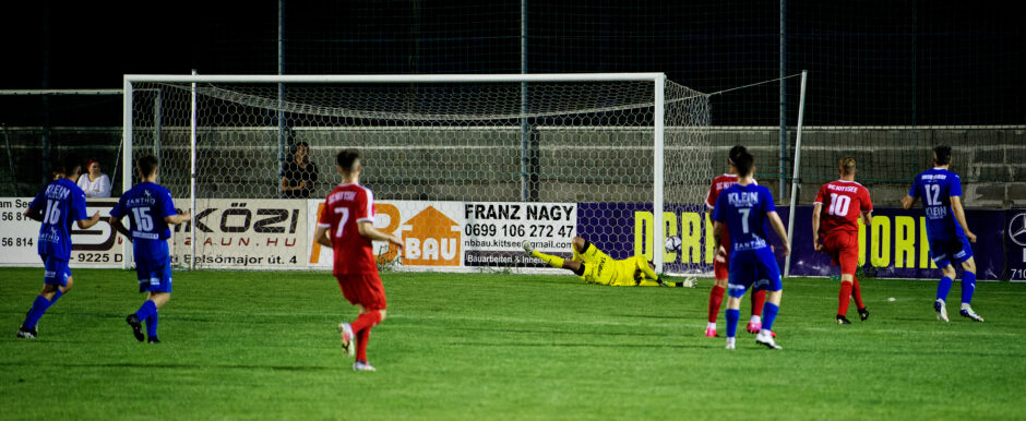 Andaui keeper Juraj Hajduch just manages to keep Sombat's shot out of the net.