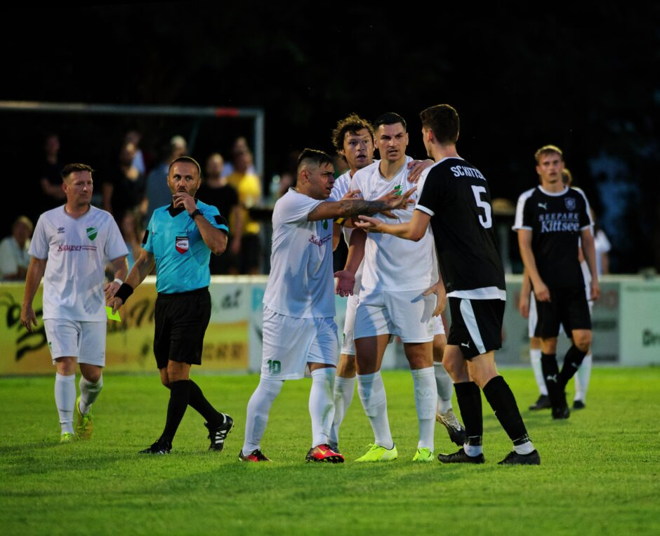 Lukas Raithofer earns a yellow card protesting Wimpassing rough play