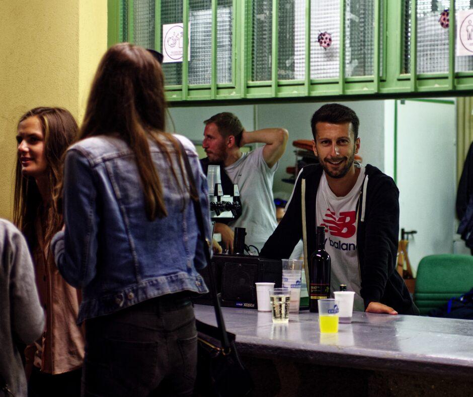 Patrick Dietmann tending bar post-match
