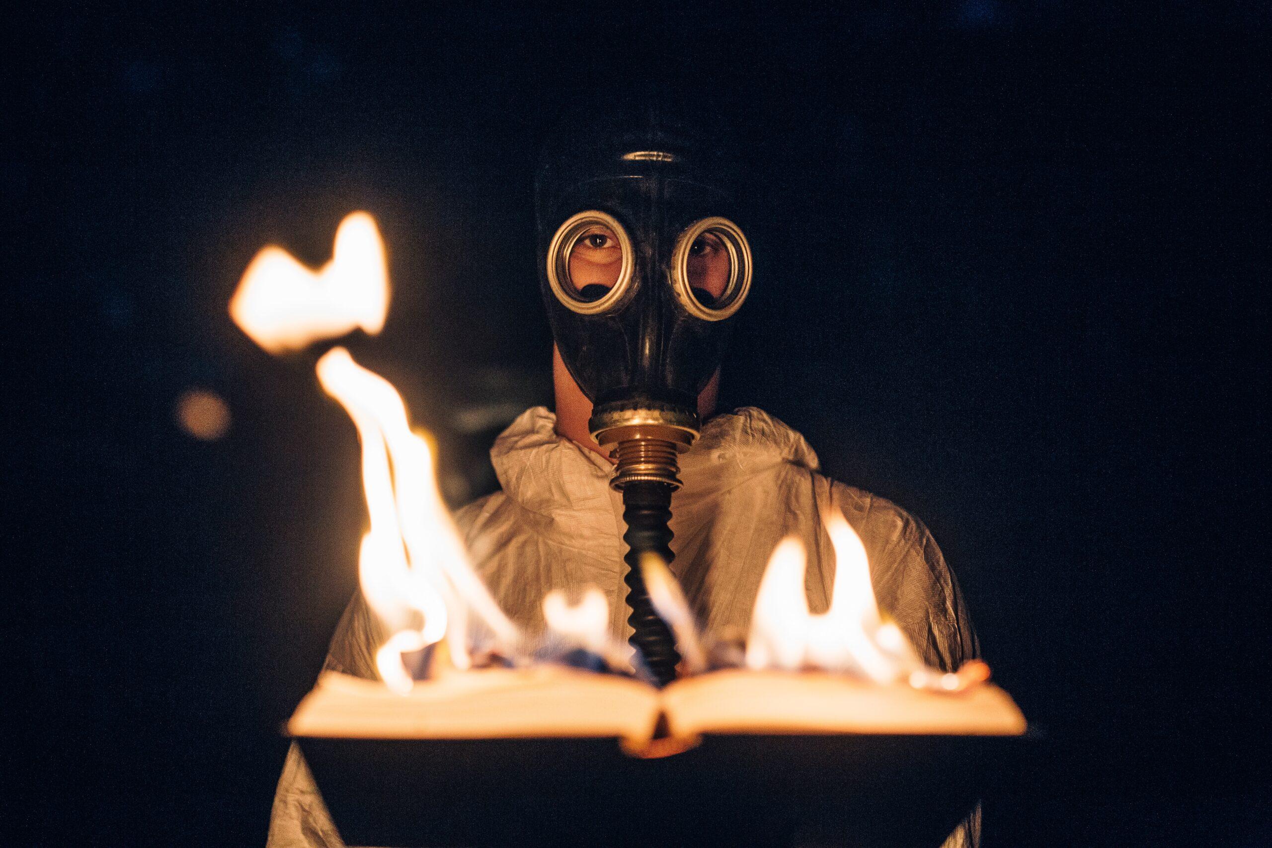 kyle-cleveland-burning-book-gas-mask.jpg