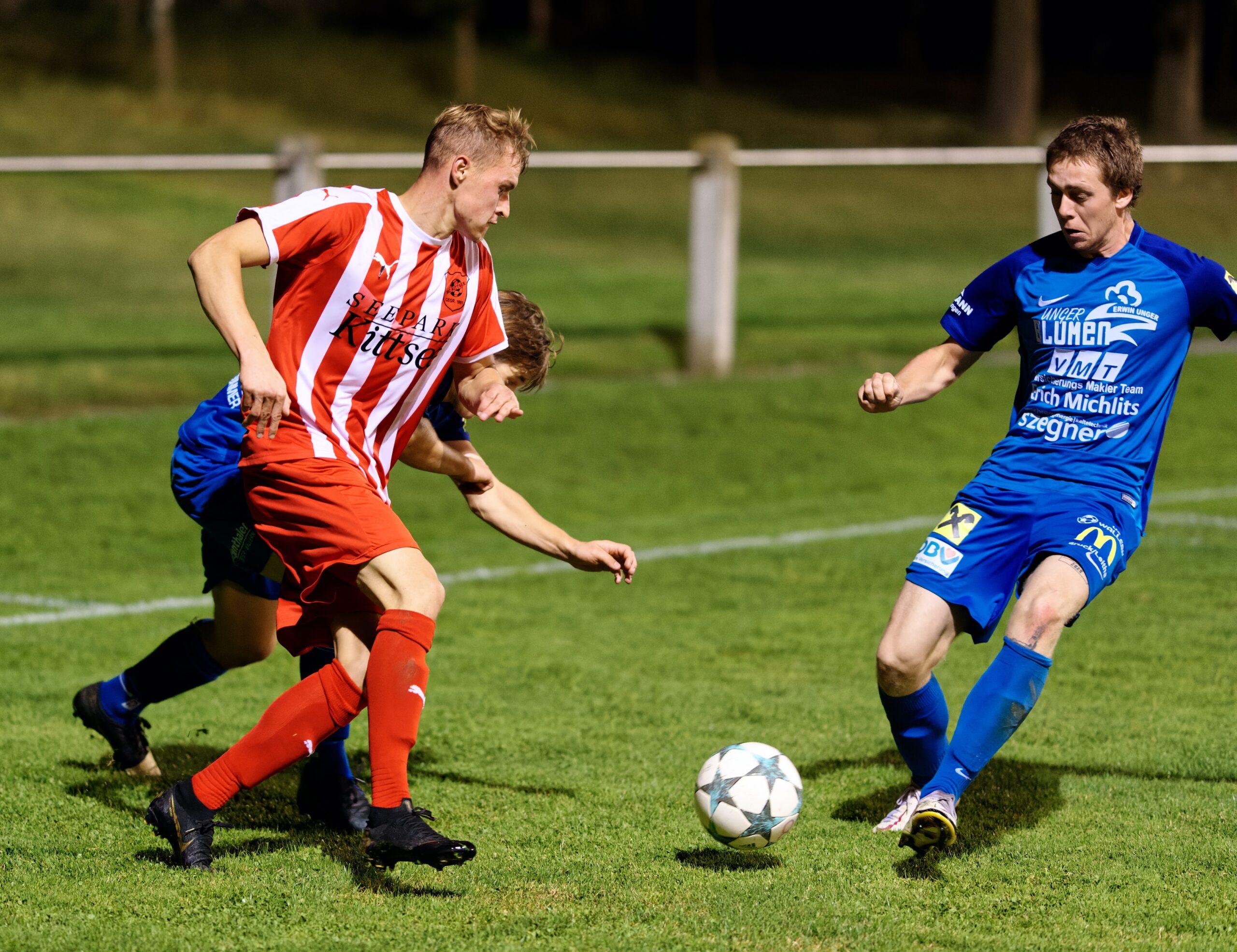 Jozef Sombat eludes two defenders